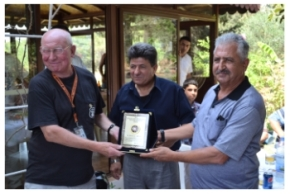8 Terry Carter (left) receives a plaque from TRNC Fire Chief, Aysin Öztrak (centre) and  Police Commander Ahmet Zaim (right)