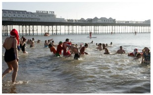 Christmas Day swimmers (Courtesy of The Telegraph, photo by Connors)