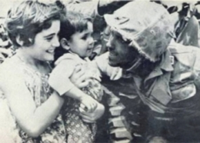 Turkish soldier with a child image