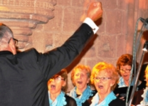 Musical Director George Ward encourages the sopranos of the Kyrenia Chamber Choir to hit a high note October 2014 Bellapais Abbey. image