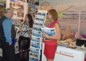 Our Russian interpreter Shamsiya and Burcu talking  to prospective clients image