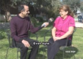 engin-speaking-to-aysel-Süleymanağa image