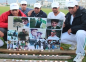 Girne cricket team with the memorial candles image