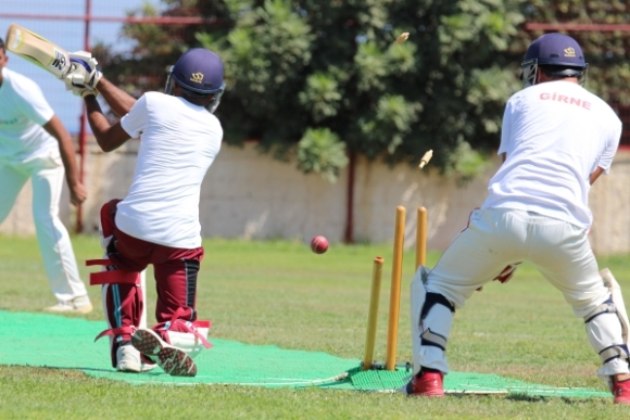 CIU's Zimbarbian Lovemore Zambezi being bowled by Girne's Sharzad