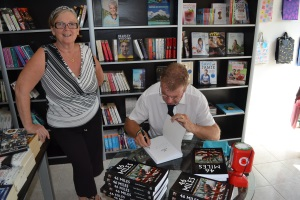 Jarra signs a book for Laura Kennedy