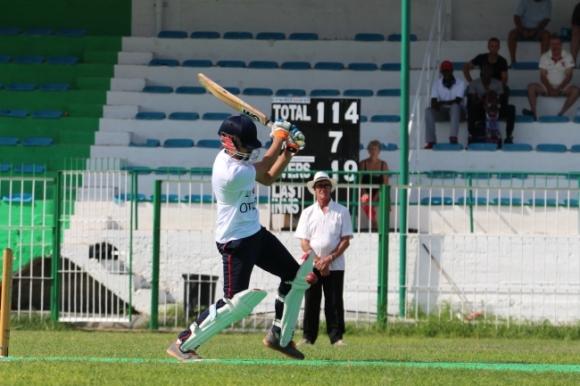 Kevin Hosford umpiring METU's batsman Muzammil