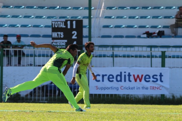 306 Cyprus All Stars bowler Mohsin with captain Aun in the background