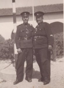Yusuf (right) and colleague at Moni Police Station