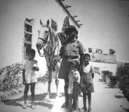 Yusuf with his horse and children Erbil, Erden and Gunay