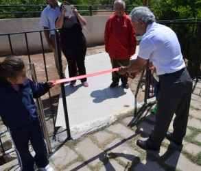 Cutting the ribbon tn the Ziyamet Special Needs School playground