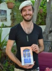"Jay Wadams with John Guthrie's book ""A bell in Bellapais"""
