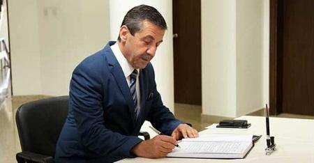 Ertugruloglu signs condolence book