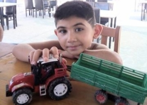 ayaz-with-his-tractor-image