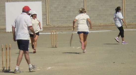 Gina Mapp and Maria Mansfield taking a run against the Limassol Ladies.